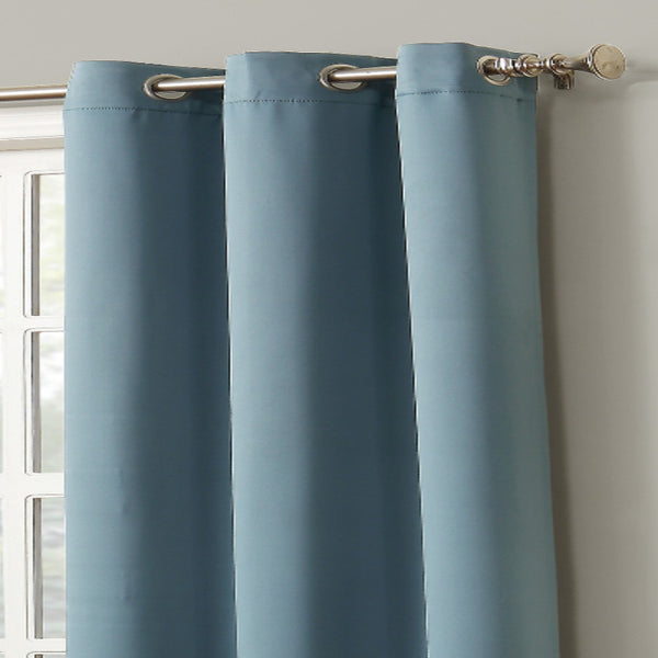 Closeup shot of mineral Sun Zero Shandriah Blackout Curtain Panel fabric and grommets