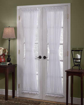 Sheer Voile Door Panels hanging on a sash rod over glass door