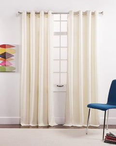 Ivory Shimmer Metallic Printed Grommet Panel hanging on a decorative curtain rod