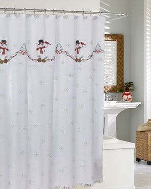 Snowman Fabric Shower Curtain hanging in a bathroom