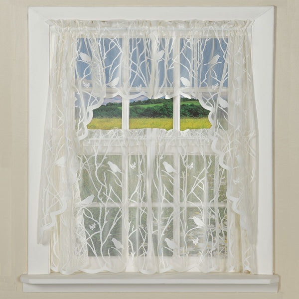 Ivory Songbird Lace Kitchen Valance, Swags, and Tier Curtains hanging on curtain rods