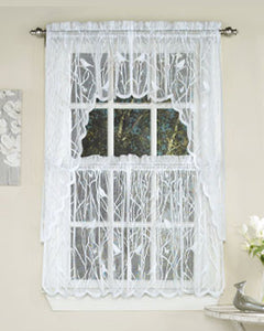 White Songbird Lace Kitchen Valance, Swags, and Tier Curtains hanging on curtain rods