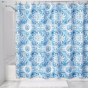 Blue Spanish Tile Fabric Shower Curtain Liner hanging on a shower curtain rod