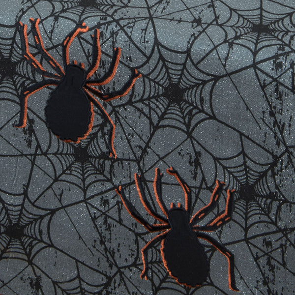 Up close shot of gray Spider Web Glitter Table Runner