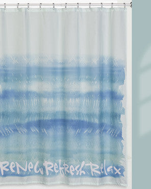 Blue Splash Fabric Shower Curtain hanging on a shower curtain rod