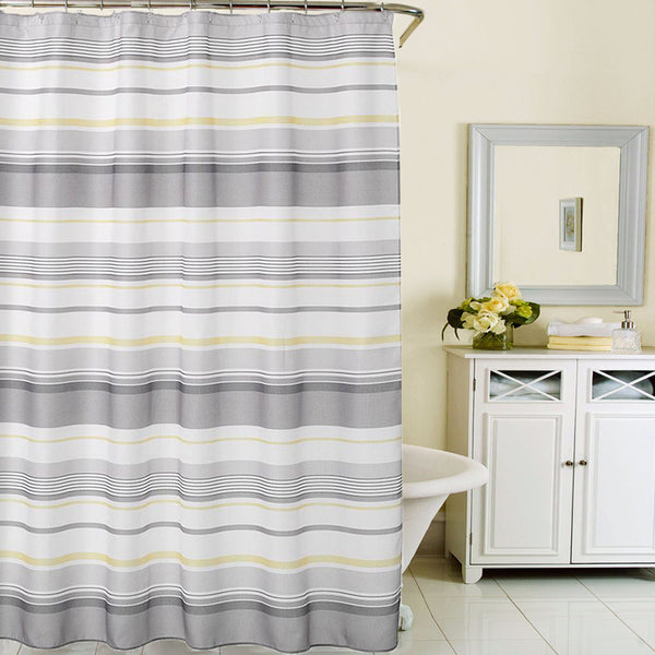 Multi Spring Garden Stripe Fabric Shower Curtain hanging on a shower curtain rod