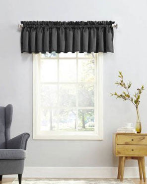 Black Sun Zero Julian Room Darken Valance hanging from a decorative curtain rod