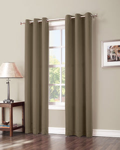 Barley Sun Zero Shandriah Blackout Curtain Panel hanging on a decorative rod