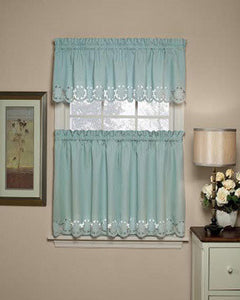 Misty Blue Taylor Kitchen Valance and Tier Curtains hanging on a curtain rod