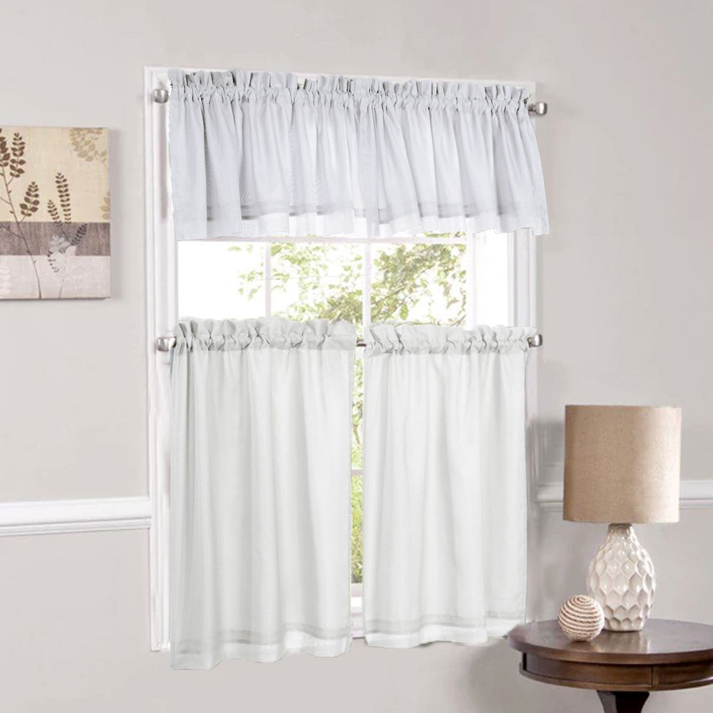 Rhapsody Lined Thermavoile Tailored Kitchen Valance and Tier Curtains hanging on decorative rods