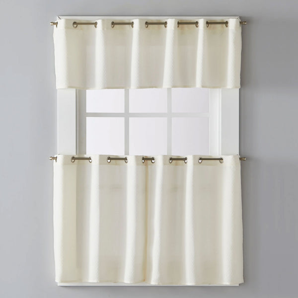 Ivory Trio Grommet Top Tier and Valance hanging on a decorative curtain rod