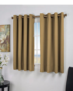 Sand Ultimate Blackout Grommet Top Shortie Panels hanging on a decorative curtain rod