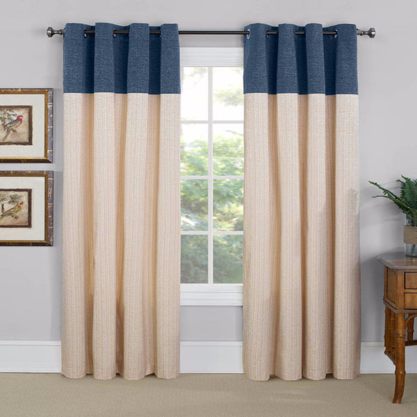 Navy Vancouver Room Darkening Grommet Top Panels hanging on a decorative curtain rod