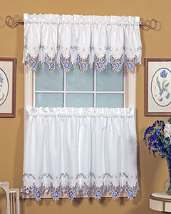 Blue and white Verona Embroidered Cutwork Kitchen Valance and Tier Curtains hanging on a curtain rod