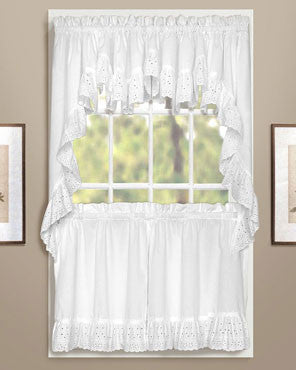 White Vienna Eyelet Kitchen Valance, Swags, and Tier Curtains hanging on curtain rods