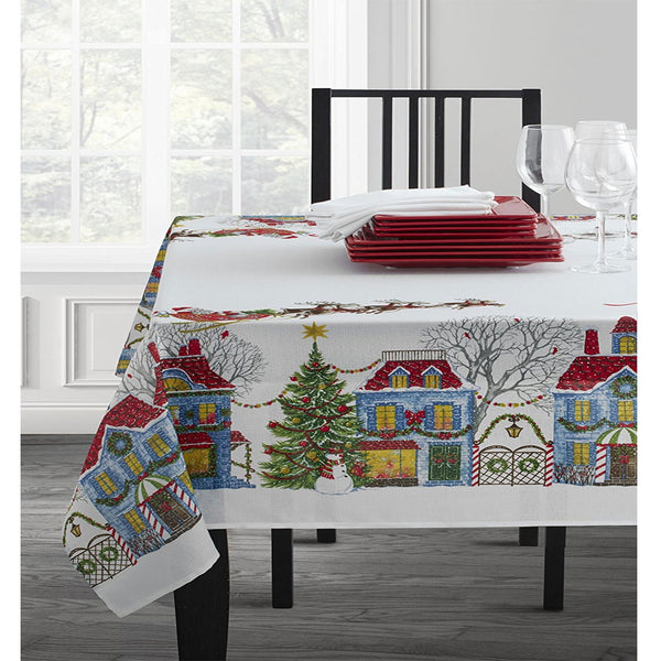 Christmas Village Textured Printed Tablecloth on a oblong table