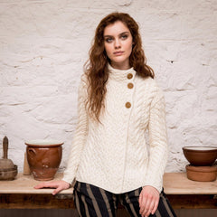 Woman in Irish side-button cardigan made from extra-soft Merino wool