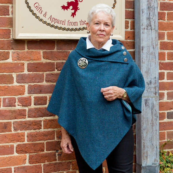 women's teal Harris Tweed poncho with metal Celtic buttons