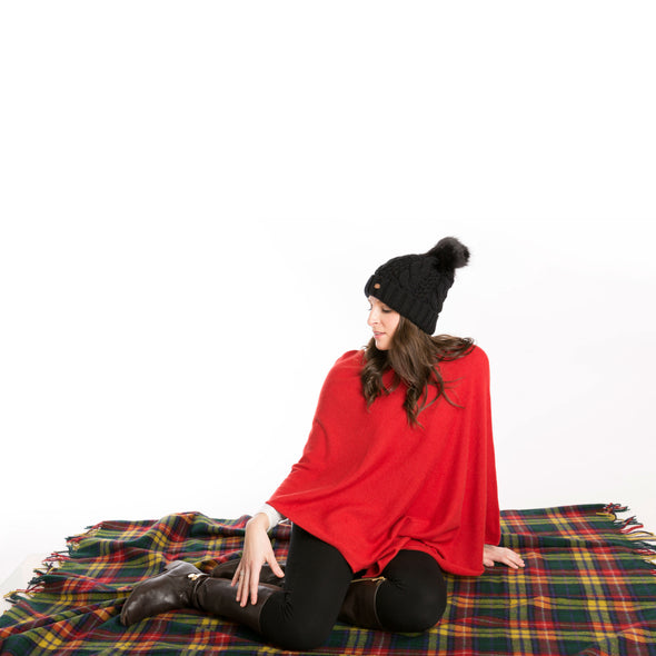girl sitting on wool tartan plaid blanket, Buchanan modern tartan