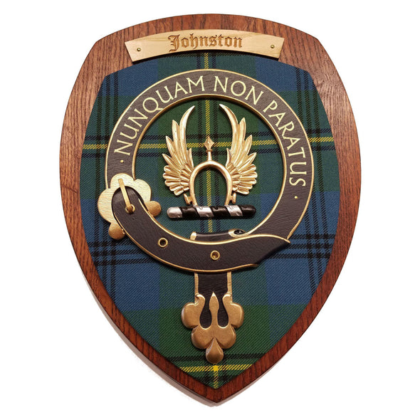wooden wall plaque with Johnston family crest & tartan
