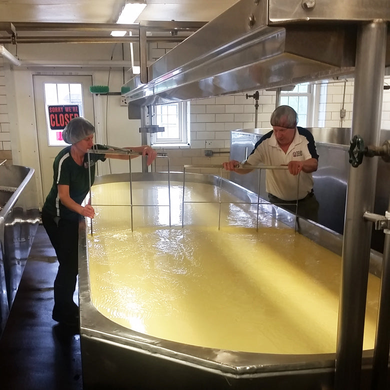 Tending to the milk tank at Hook's Cheese