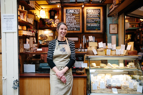 Anne Saxelby in front of the cheese counter at the original Essex Market shop