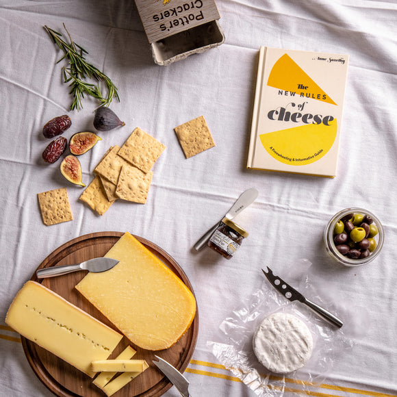 Saxelby's Cheese Starter Kit - a collection of cheeses, accompaniments, cheese knives, cheese board and book