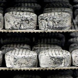 Wheels of Sherry Gray, a double cream cheese, ripening in the Cellars at Jasper Hill Farm