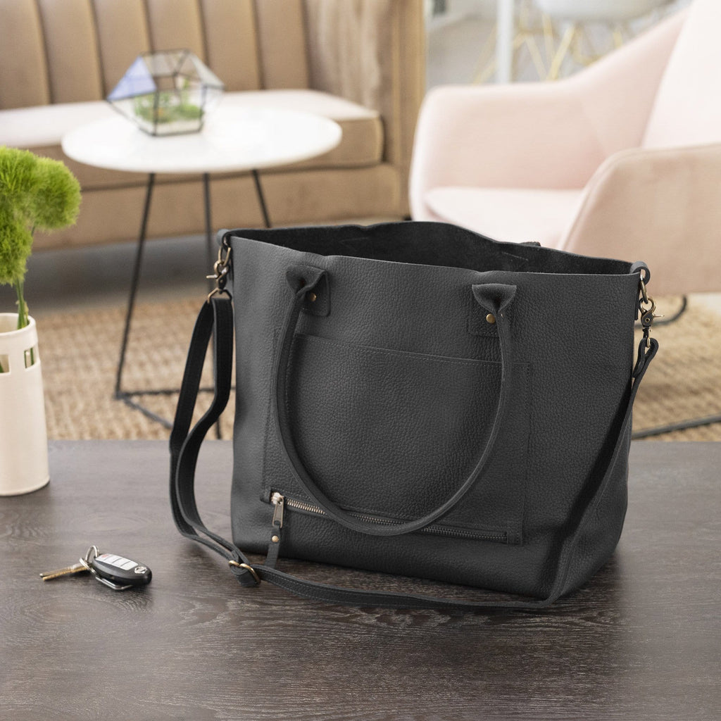 The SUMNER™ Crossbody Tote - Pebbled Black in a home setting