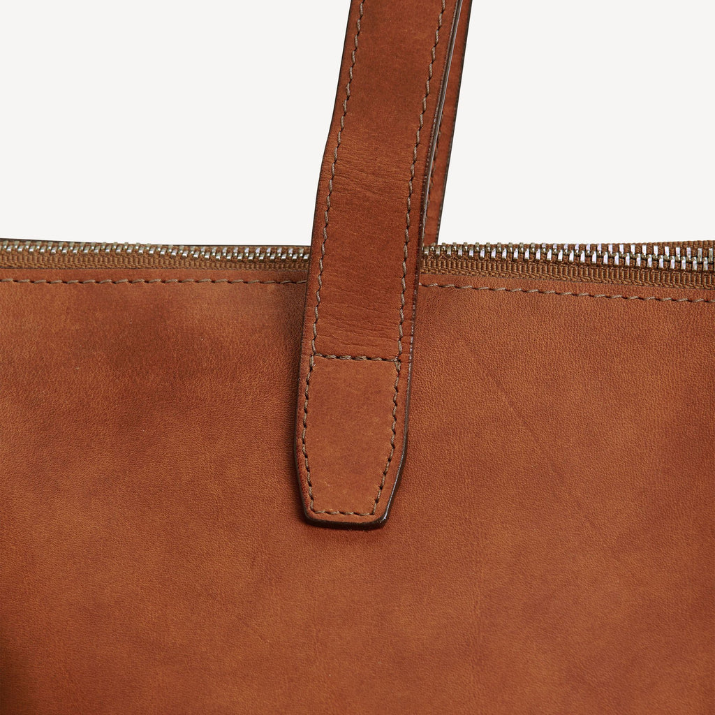 The BALLARD TOTE™ - Tan showing the strap stitching
