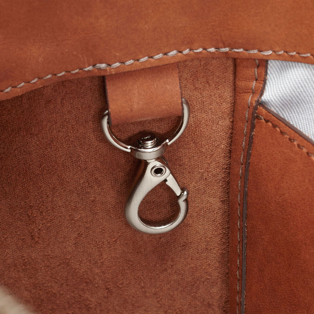 a closeup of The BALLARD TOTE™ - Tan showing the strap hook