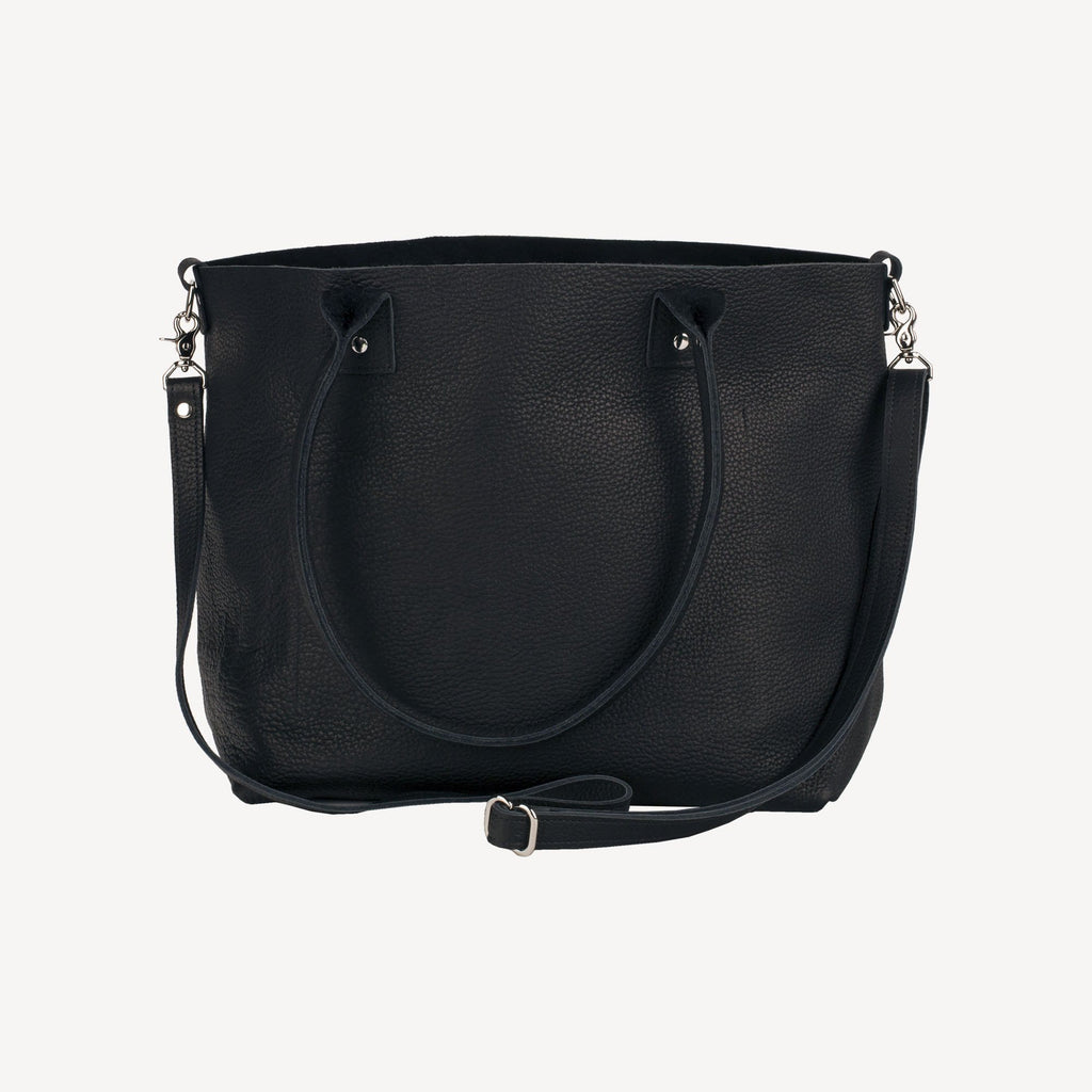 side-view of The SUMNER™ Crossbody Tote - Pebbled Black with the strap and handle down