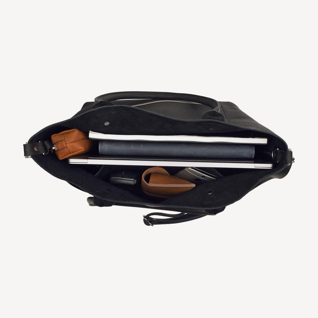 An aerial view of the front view of The SUMNER™ Crossbody Tote - Pebbled Black showing the storage capacity