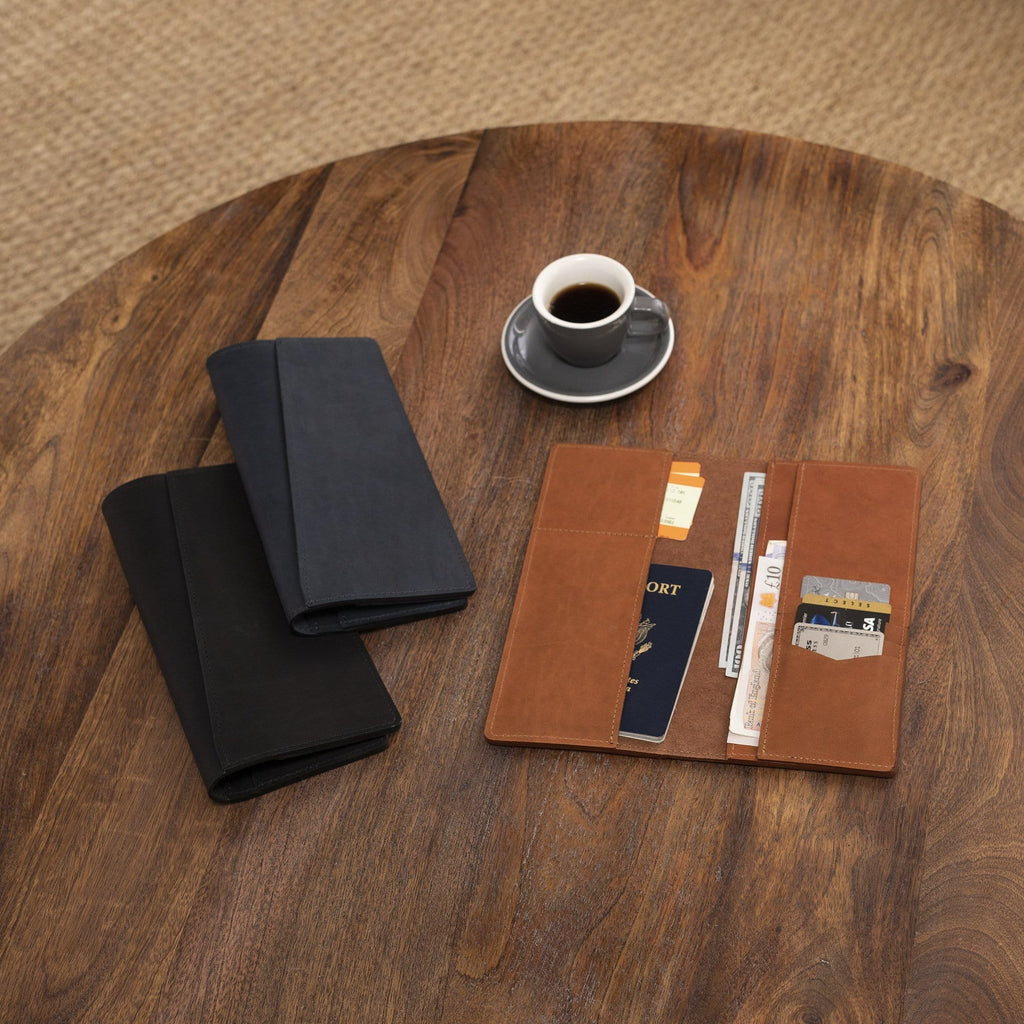 aerial view of The LAKEWAY™ Travel Wallet - Tan on a coffee table with other products