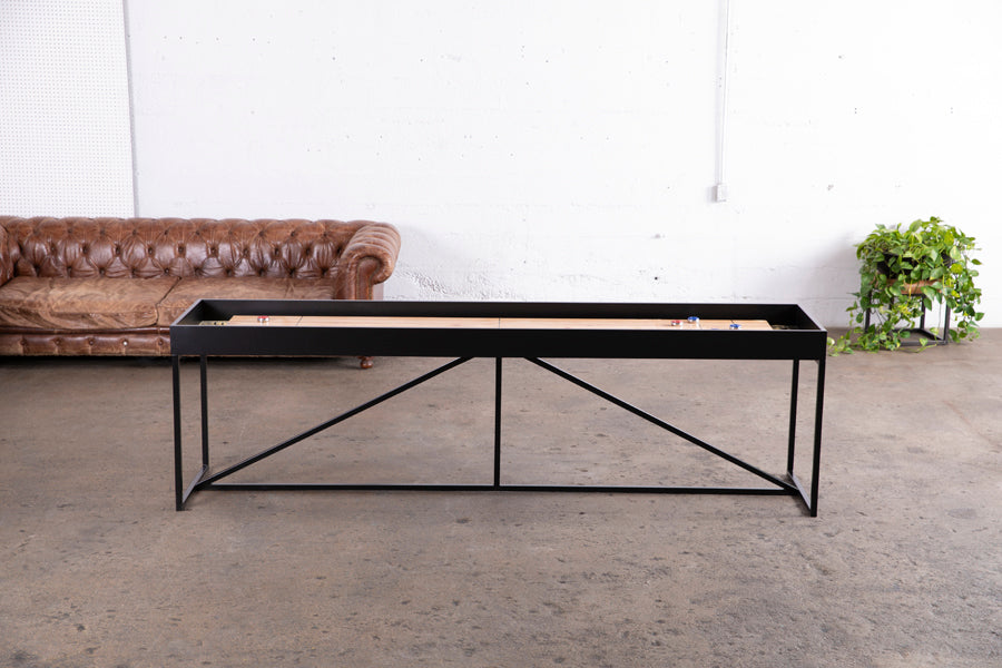 black shuffleboard table