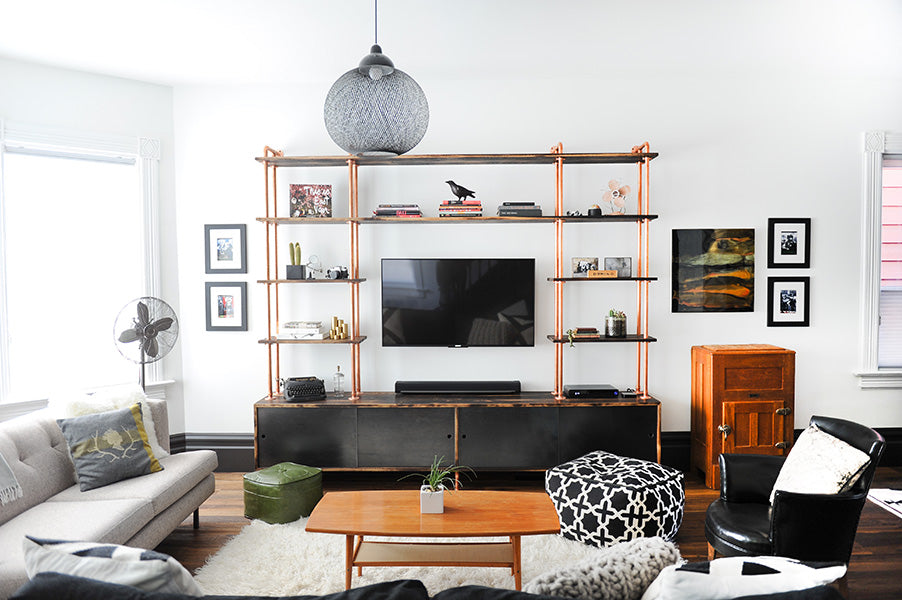 custom wall unit featuring copper pipes and ample storage