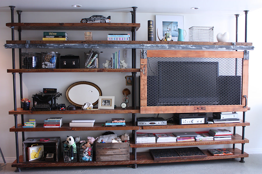 built-in shelving from reclaimed wood and pipes
