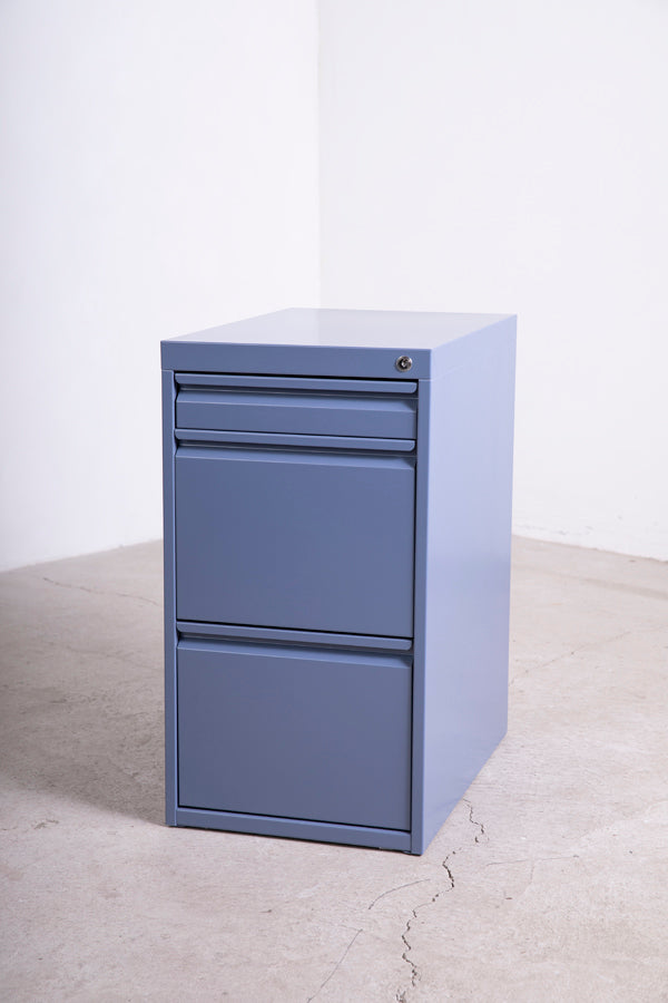 blue metal filing cabinet