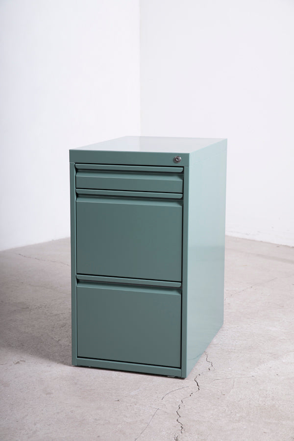 green metal filing cabinet