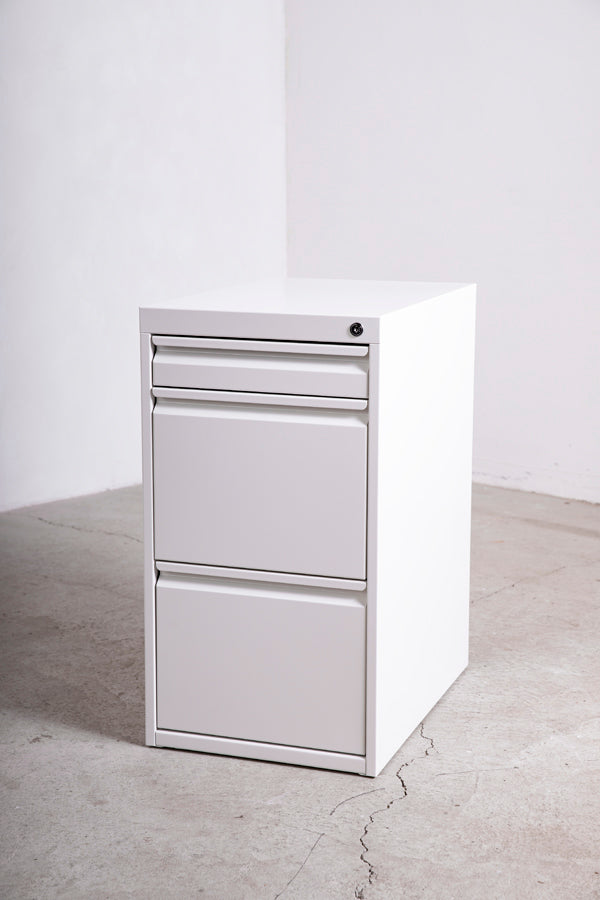 white metal filing cabinet