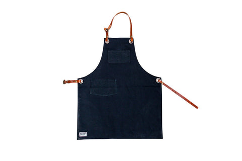 black canvas apron with pockets and leather straps