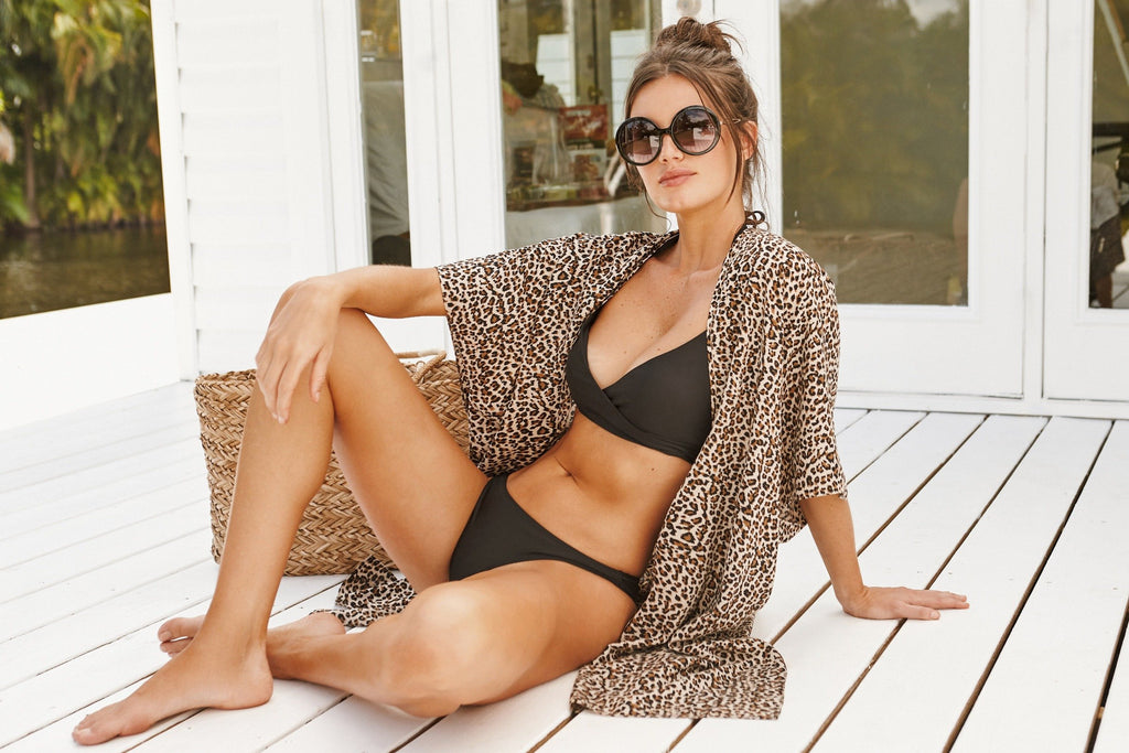 leopard print coverup and kaftan with slits that add coverage for any beach, tropical, or resort vacation! Made in collaboration with vancouver women-owned clothing and loungewear line brunette the label. Leopard beach kimono, kimono coverup canada.