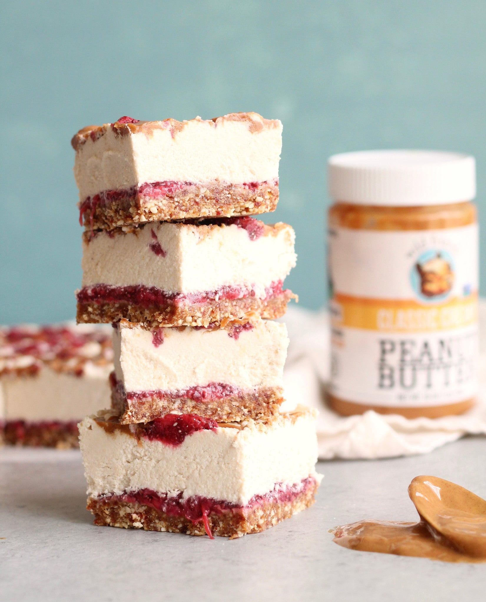 Peanut Butter & Strawberry Chia Jam Cashew Cheesecake Bars