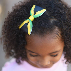 Girl wearing Jamaica flag hair bow