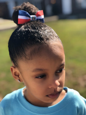 Girl wearing Dominican flag hair bow