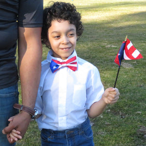 Puerto Rico bow tie on boy holding flag