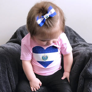 Baby girl wearing El Salvador flag hair bow