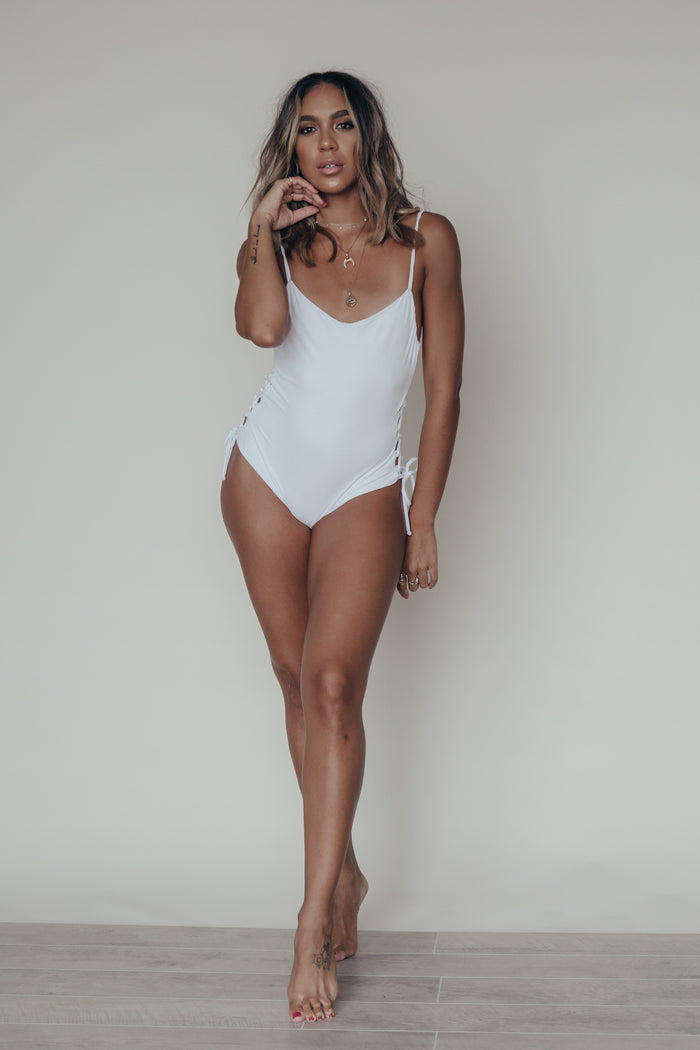 luli one piece in white suede