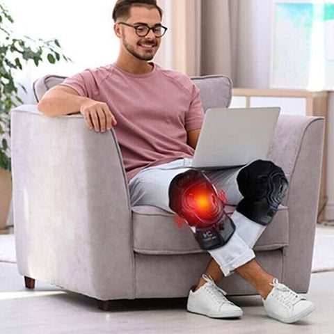 man enjoying knee therapy with the MKV Knee Massager 2.0