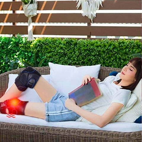 Woman relaxing with the MKV Knee massager
